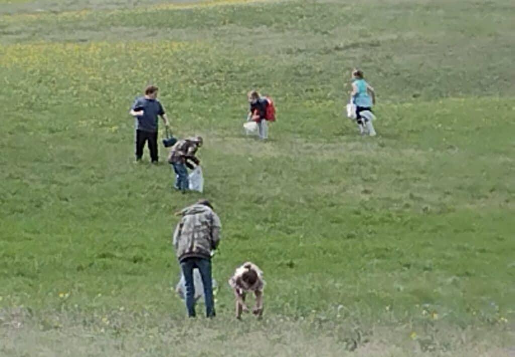 Picture of older children hunting for hidden eggs