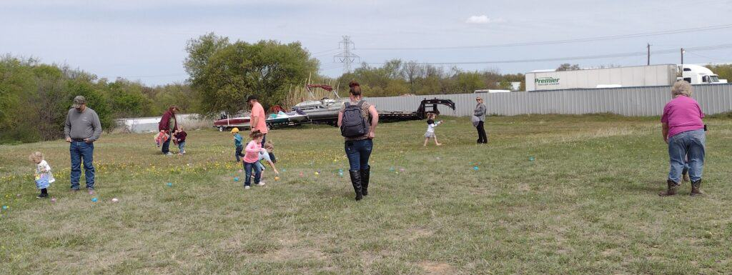 Picture of the younger children hunting for hidden eggs