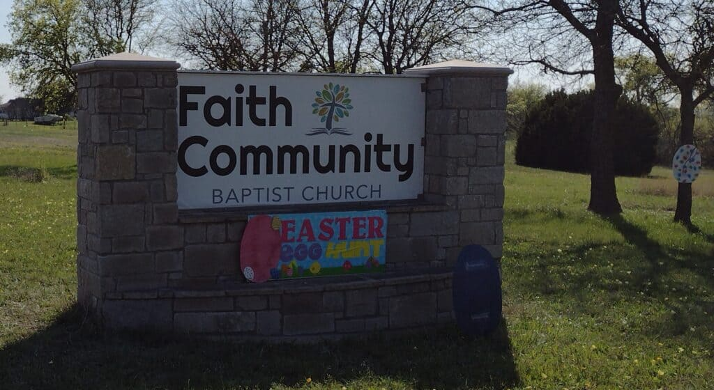 Picture of our street sign, decorated for our Egg Hunt and Kite Flying Spring Outreach